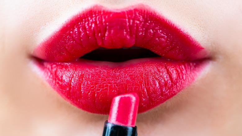 Woman wearing a reddish pink lipstick