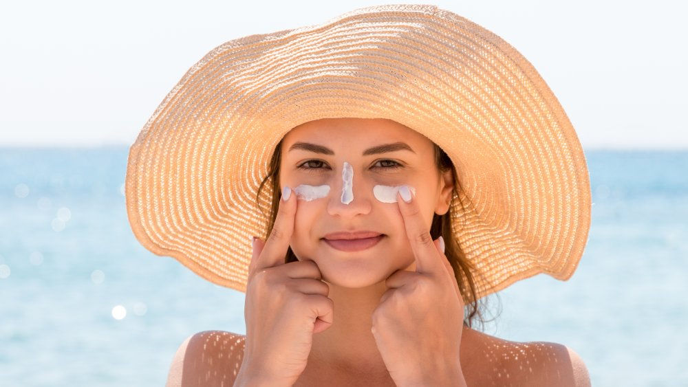 Woman tanning with sunblock