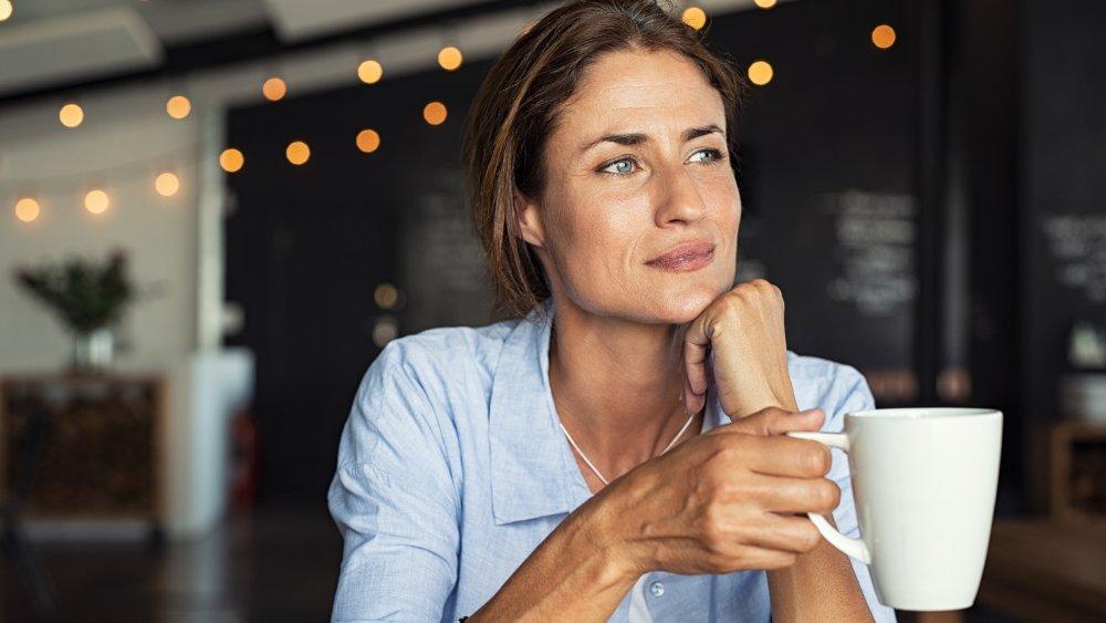 Woman drinking coffee (or tea)