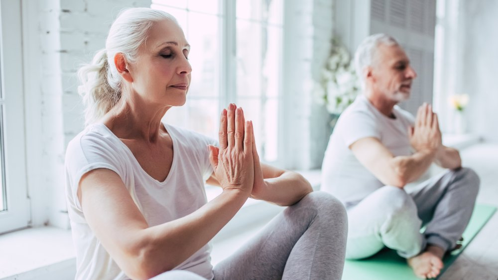 A senior couple doing yoga together