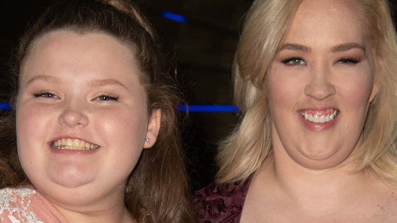 Alana Thompson and Mama June pose together at an event
