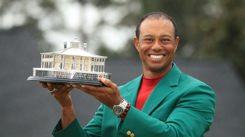 Tiger Woods posing with trophy
