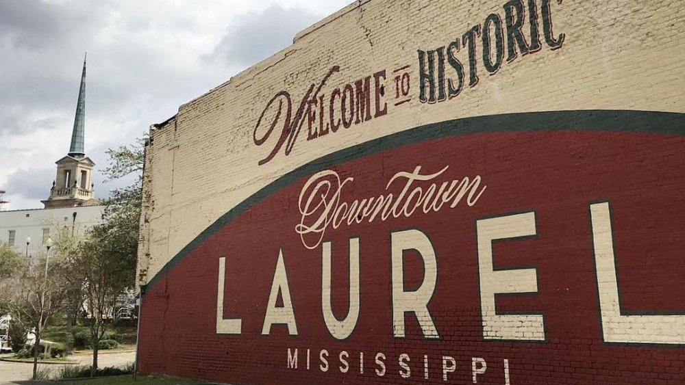 painted welcome to laurel sign