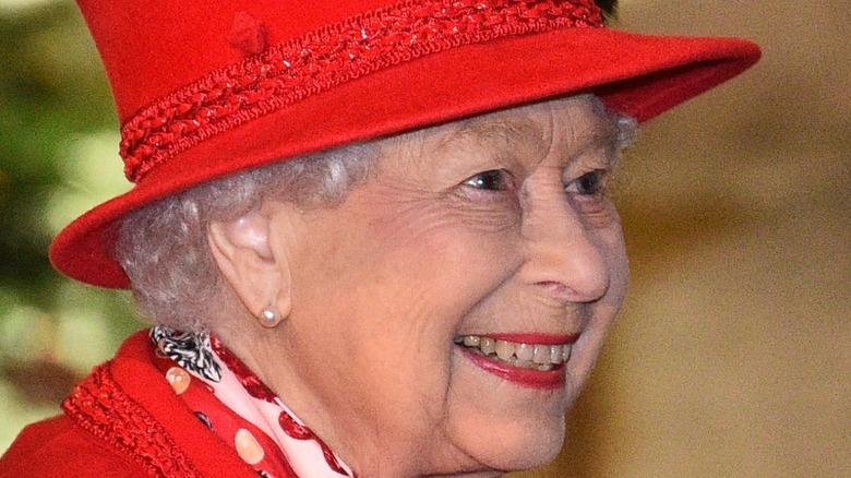 Queen Elizabeth II in red hat