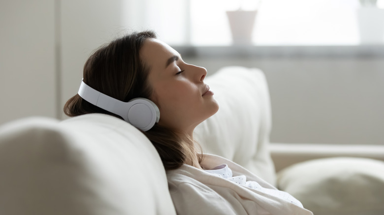 A woman resting with headphones on