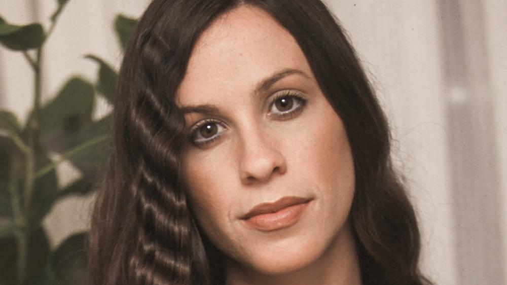 Alanis Morissette posing