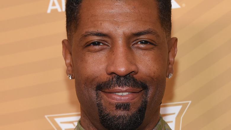 Deon Cole posing on red carpet