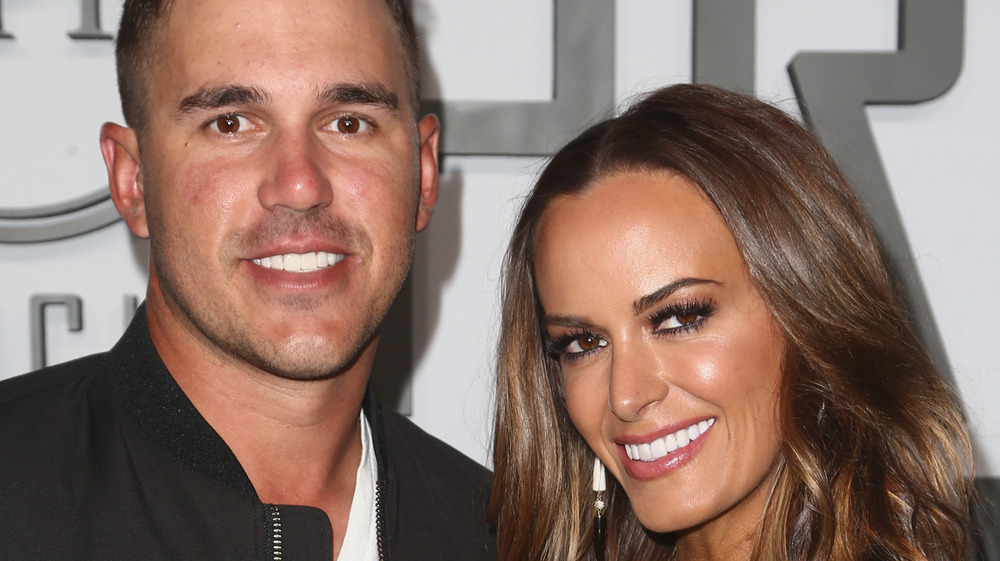 Brooks Koepka and Jena Sims at event