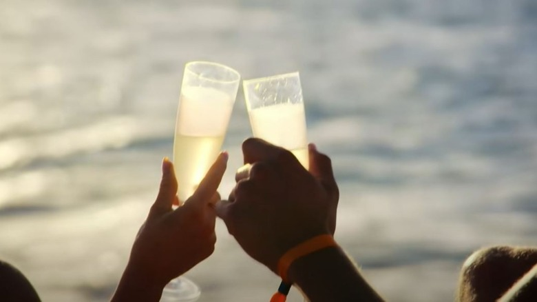 Two people clinking champagne glasses