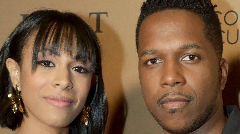 Leslie Odom Jr. and wife Nicolette Robinson pose on the red carpet together
