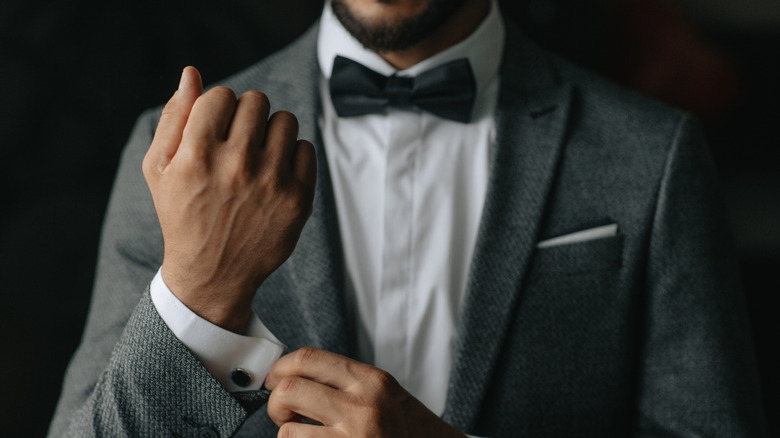 Black man wearing a suit and bow tie