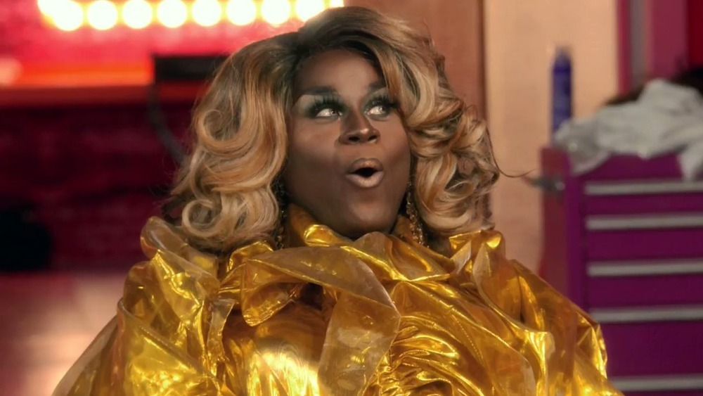 LaLa Ri in a gold dress