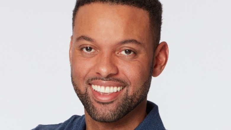 """Karl Smith smiling in promotional photo for """"The Bachelorette"""" Season 17"""