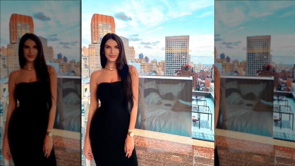 Corrine Jones poses on balcony in black
