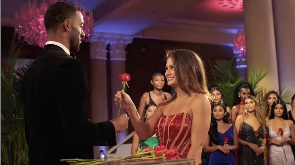 Kaili Anderson receiving rose on the Bachelor