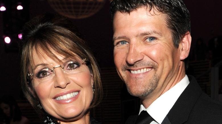 Sarah Palin, Todd Palin posing at event