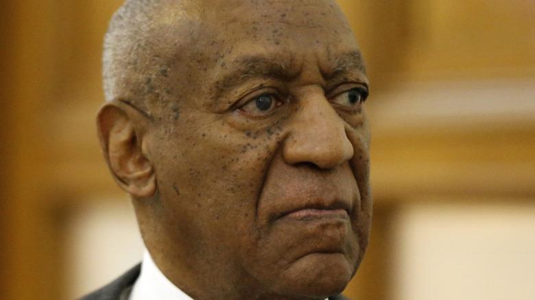 Bill Cosby wearing a dark suit