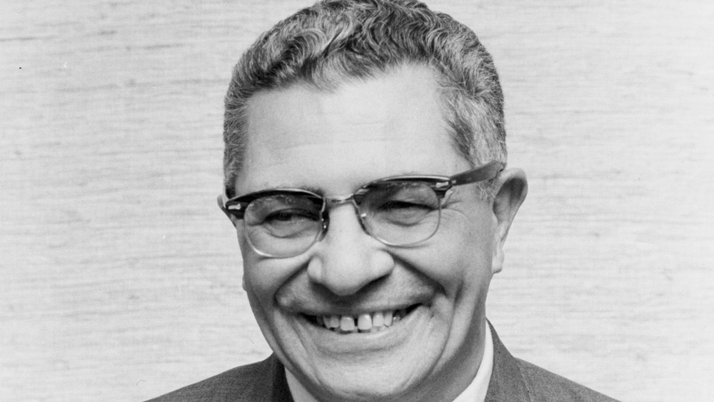 Vince Lombardi smiling, black-and-white photo