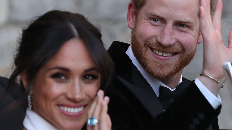 Meghan and Harry wave on their wedding day