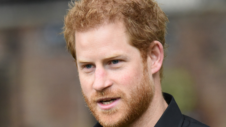 prince harry in a black t shirt