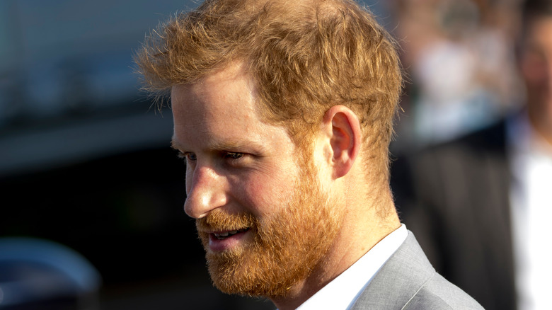 Prince Harry wears a gray suit