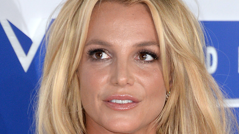 Britney Spears rocks a black dress at an event.
