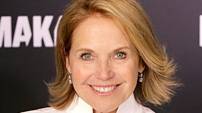 Katie Couric smiles onstage