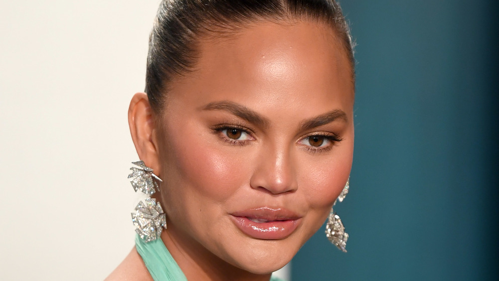Chrissy Teigen with hair pulled back