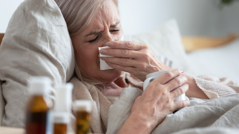 Woman with cough medicine