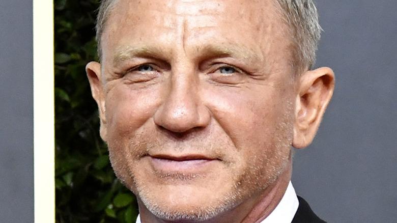 Daniel Craig smiles on the red carpet