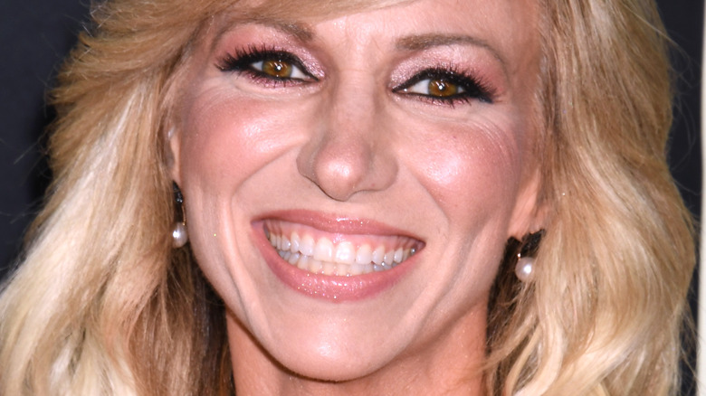 close up of Debbie Gibson smiling broadly