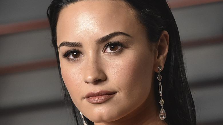 Demi Lovato wearing diamond earrings