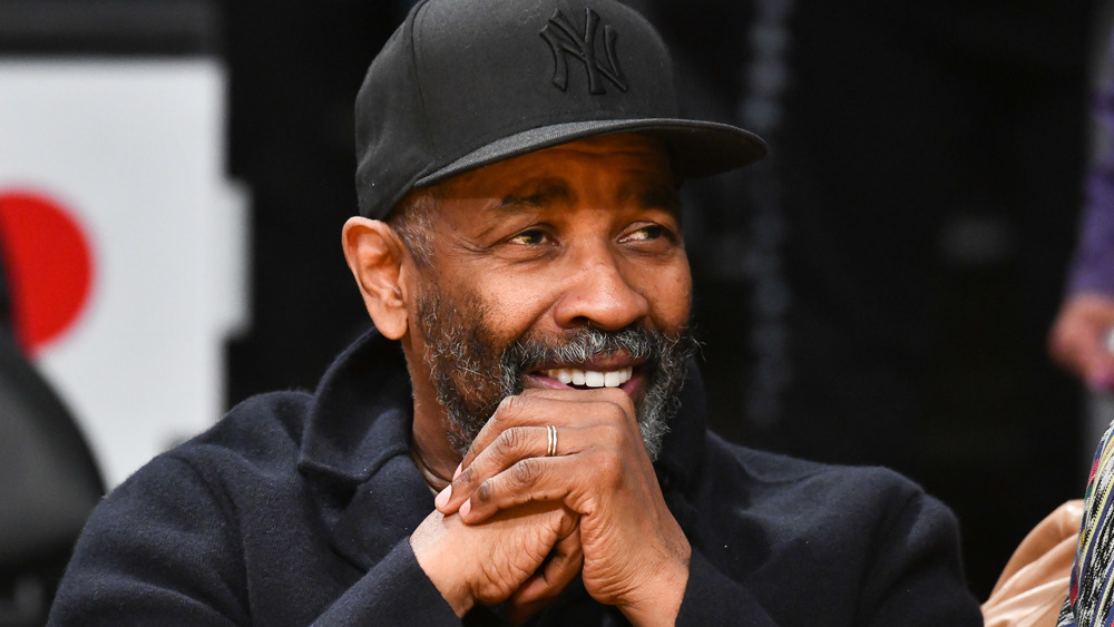 Denzel Washington in black baseball hat