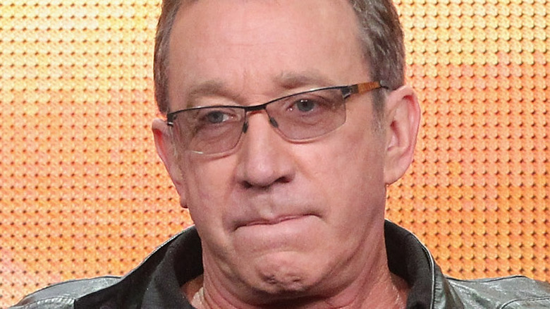 Tim Allen looking serious in glasses