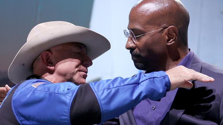 Jeff Bezos and Van Jones embracing