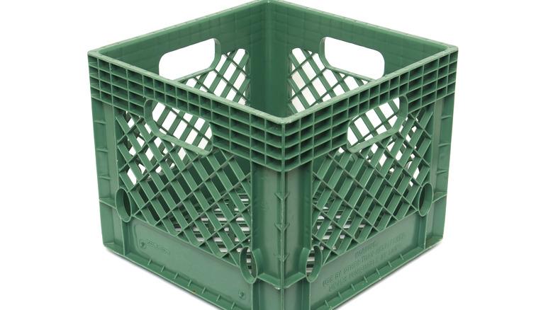 Green plastic milk crate