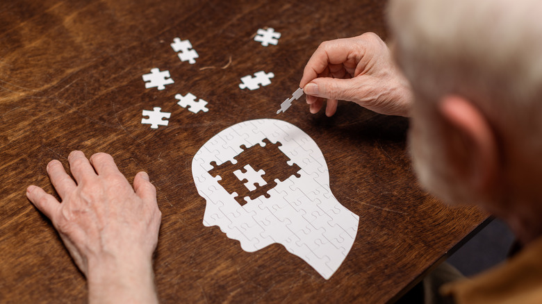 Man putting a puzzle together