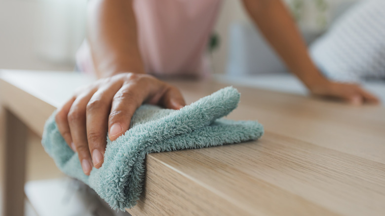 A woman cleaning a table