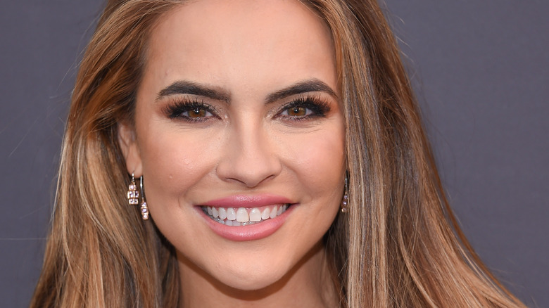 Chrishell Stause smiling with her hair half back