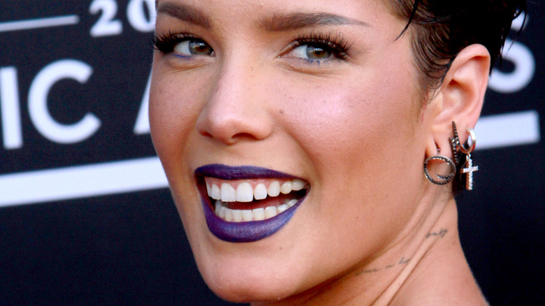 close up of Halsey with short hair and dark lipstick