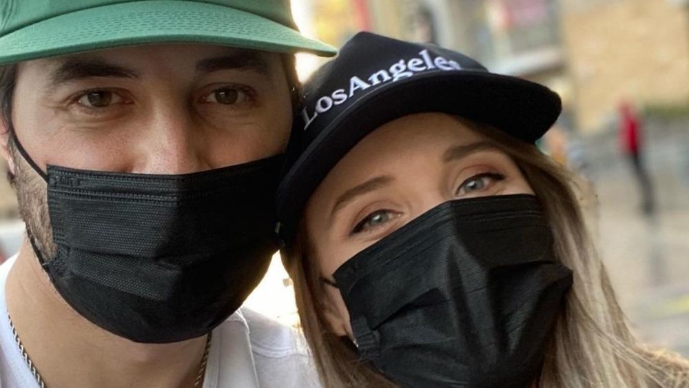 Jeremy and Jinger Vuolo wearing face masks