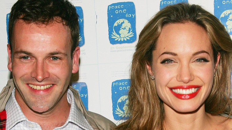 Angelina Jolie and Jonny Lee Miller at an event
