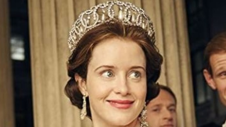 Claire Foy smiling in The Crown
