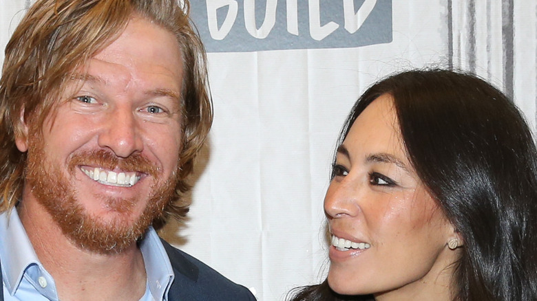 Chip and Joanna Gaines attending an event