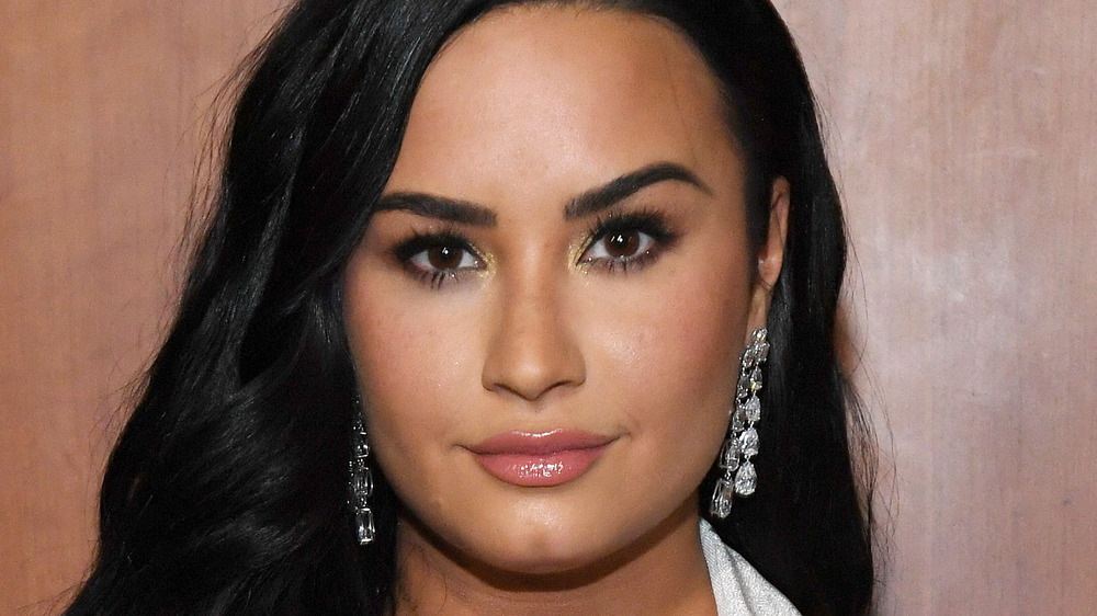 Demi Lovato looking serious with short pink hair