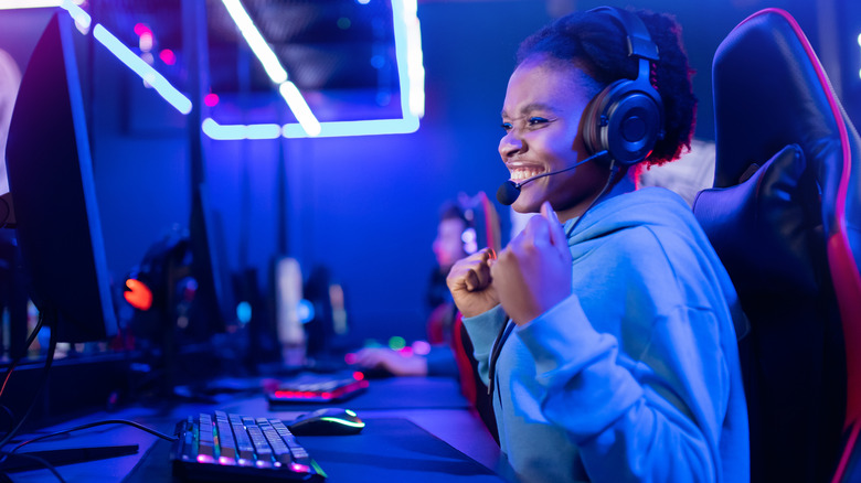 Young woman gamer smiling