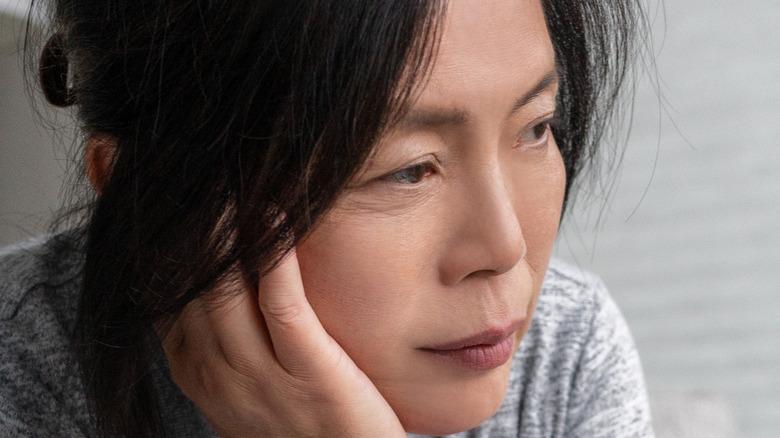 Women in grey shirt sitting alone