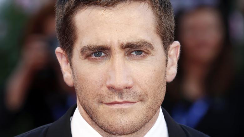 Jake Gyllenhaal posing in a suit