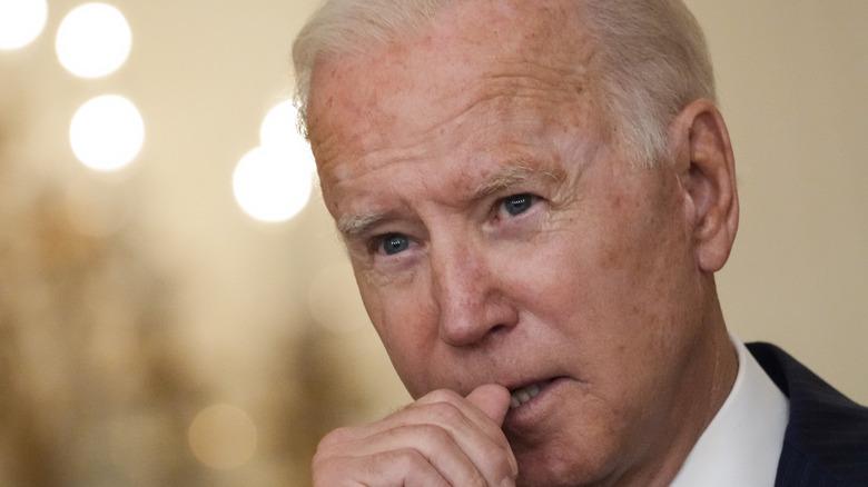 Joe Biden listens to a question