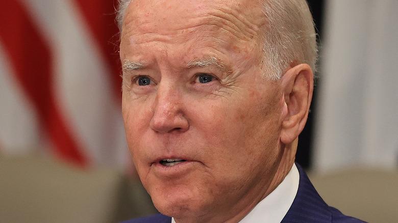 Joe Biden on July 12 at a meeting, wearing a blue suit